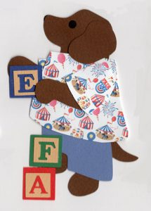 "I for initials, Dog with alphabet block spelling the initials ""EFA"""