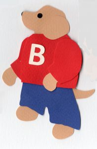 "L for letter, Dog wearing shirt with the letter ""B"" on it"