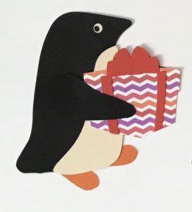 P for present, Penguin holding a wrapped present with a bow