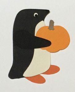 P for pumpkin, Penguin golding a pumpkin