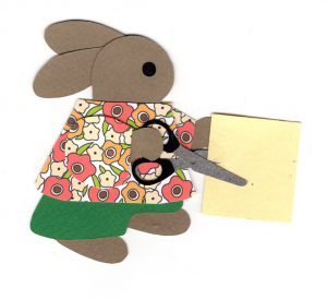 S for scissors, Rabbit using scissors to cut a piece of paper