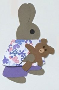 T for teddy bear, Rabbit holding a teddy bear