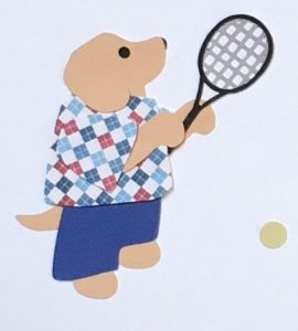 T for tennis, Dog holding a tennis racket standing near a tennis ball