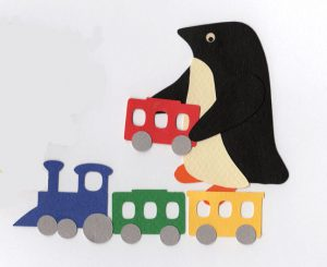 T for train, Penguin adding a red toy train car to a toy train with a blue engine and green and yellow cars