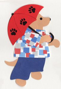 U for umbrella, Dog holding an umbrella with paw prints on it