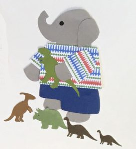 D for dinosaurs, Elephant holding a toy tyrannosaur surrounded by more toy dinosaurs
