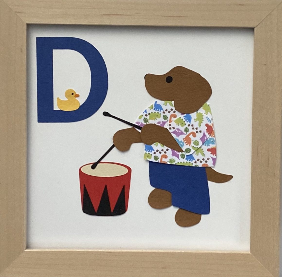 D initial sign - Dog playing drum, with a duck, and a dinosaur shirt