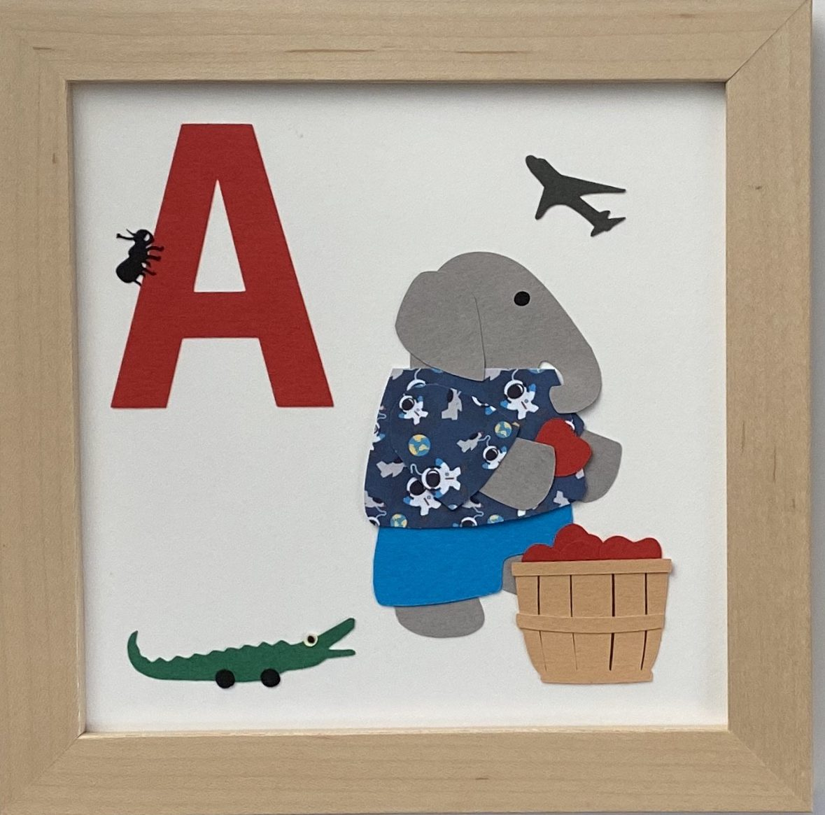 A initial sign - Elephant with alligator, ant, airplane, apples, and a shirt with astronauts